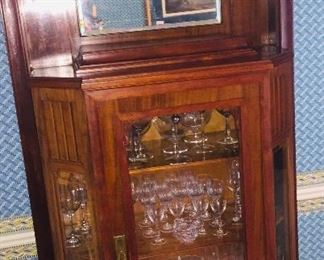 Turn of the last century china cabinet filled with Waterford crystal