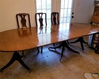 HUGE wooden table with 3 leafs and 11 chairs. Can seat 16