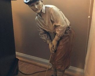 Old style golfer statue