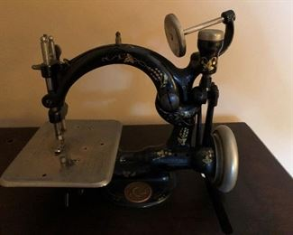 Wilcox and Gibbs pedal operated sewing machine and base. Circa 1892. Excellent condition