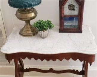 Marble top end table, lamp, and clock