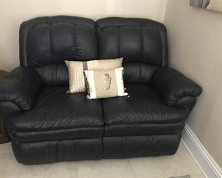 Leather (where you sit) reclining loveseat