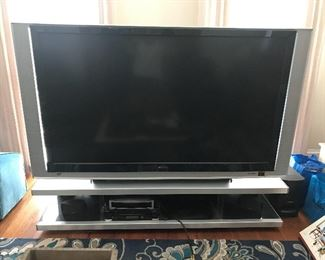 Early 2000s large TV.  This would be a good gaming tv for the kids or for the youth room at church.   You will need 3 guys to move this baby.