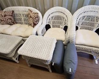 7020: White Wicker Furniture set w/ Decor Pillows and Cushions Gorgeous and soooo patio-ready! This is a super cute white wicker patio set with two chairs, a rocker, love seat, side and coffee table w/ decor pillows and cushions