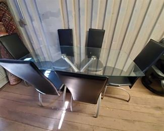 7025: Glass Dinner Table w/ Metal and Stone Base & Six Chairs Beautiful Thick cut glass table top with metal and granite stone base. Six Leather wrapped chairs
