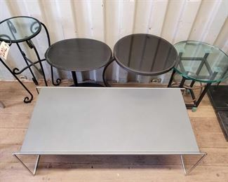 7027:Four Side tables and A Coffee Table Three side tables have removeable glass tops. Coffee table is metal with removable side legs