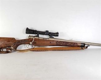 """295: Interarms Mark X Bolt Action .416 Taylor Rifle, with Scope, Leather Strap, and Booklet Serial Number: B287095 Barrel Length: 23.25""""  Classic Safari Hunter Express .416 Taylor. Stock is hand carved with oak leaves pattern. Has Leupold Vari-X III 1.5x5 scope. Has tooled leather shoulder strap. Includes booklet of information about this rifle and various info related to .416 Taylor ammunition.  California Transfer Available. Ca and out of state shipping available to your local FFL. Buyer is responsible for checking local laws before bidding."""