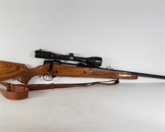 """297: Nikko Golden Eagle Model 7000 Bolt Action .375 H&H Mag Rifle Serial Number: N023170 Barrel Length: 26.75""""  California Transfer Available. Ca and out of state shipping available to your local FFL. Buyer is responsible for checking local laws before bidding."""