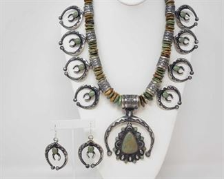 """151: IMPORTANT Native American Sterling Silver Squash Blossom Set with Amazing Green Turqouse 391.8g Authentic LARGE Navajo squash blossom necklace set !! WOW!! This is an exquisite  unique version of the historically significant pomegranate design originating from Spanish influence upon the Navajo Indian jewelry from the early 1920's! This necklace is unique and symbolic of fertility, birth, and rebirth. It takes the name squash blossom from it's three distinct parts: plain round beads, beads that make up the petals, and the horseshoe type pendant at the bottom called the Naja. The petals on this necklace are sterling silver crescents sprouting smaller crescents with a small jade jewel connecting the two. This is the symbol of a child in the womb, highly symbolic and significant to this culture. This necklace is a MAGNIFICENT specimen of authentic Navajo-specific jewelry. Bears designer stamp back. Matching earrings part of this set. Weighs approx 391.8g Measures approx 30"""" Low Estima"""