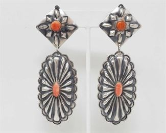 """152:Spiny Oyster and sterling silver Native American earrings.. Marked by Artist 22.5g Dashing Spiny Oyster and sterling silver Native American earrings!!  These are absolutely lovely! Weighs approx 22.5g Measures approx 4"""" Low Estimate: 125.00 High Estimate: 175.00"""