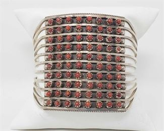 """156:  Zuni 10 Row Handmade Sterling Silver Coral Bracelet -S. Livingston Bracelet Zuni 10 row Handmade Bracelet made out Sterling Silver and Coral!                                    Measures: 5-1/4"""" inside cuff with a 1-1/4"""" gap.  Weighs approx 39.5g  Low Estimate: 400.00 High Estimate: 600.00"""