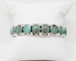 163:  Beautiful Sterling Silver and Green Turquoise Native American Bracelet Cuff 40.3g Beautiful Sterling Silver and Green Turquoise Native American Bracelet Cuff Weighs approx 40.3g