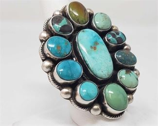 165:Original Kathleen G Marked Chunky Sterling Silver and Turquoise Cluster Ring in a size 8 Original Kathleen G Handmade Native American Chunky Sterling Silver and Turquoise Cluster Ring in a size 8 .. Weighs approx 28.2g  Low Estimate: 500.00 High Estimate: 750.00