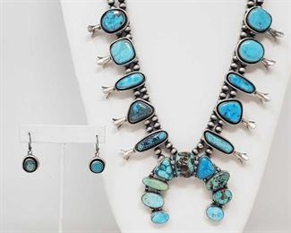 """168: Authintic One of A Kind Artist Marked Sterling Silver and Turquoise Squash Blossom SET One of A Kind Artist Marked Sterling Silver and Turquoise Squash Blossom SET Weighs approx 149.5g Measures approx 24"""" Low Estimate: 1500.00 High Estimate: 2500.00"""
