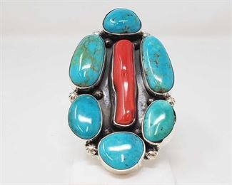 """149: One of a Kind Chunky Native American Ring with Large Coral and Turquoise Stones Artist Marked One of a Kind Chunky Native American Ring with Large Coral and Turquoise Stones  Set in Heavy Sterling Silver Complete with makers stamp and Zia logo, measures about 4"""" and weighs 111.8g  Size 8.5 Low Estimate: 800.00 High Estimate: 1200.00"""