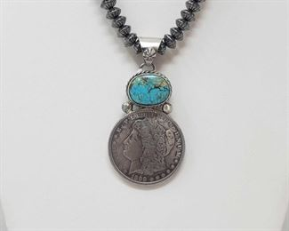 """174: Beautiful Artist Marked Sterling Pendent with a Authentic Morgan Silver Dollar (chain not included) Beautiful Artist Marked Sterling Pendent with a Authentic Morgan Silver Dollar (chain not included) Chain not included Weighs approx 38.6g Measures approx 2.5"""""""