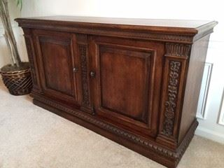 Quality!!  Solid Wood!!  Beautiful wood carving accents.  Two Doors and lots of storage inside!