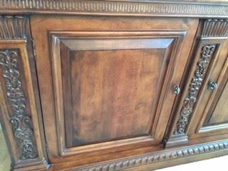 Notice Raises wood Panel doors  Intricate carvings