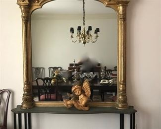 large gold leaf mirror  5' x6 ' on iron and marble base