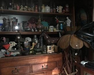Antique oak wall unit overflowing with collectibles