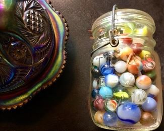 Carnival glass covered dish and  jar of vintage marbles