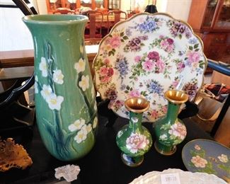 The two green vases to the right have been removed from the sale by the client. Our apologies.