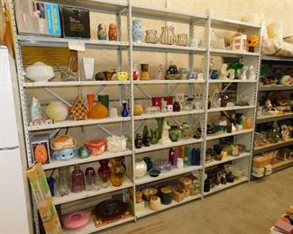 Shelves and shelves of items, all the way around the RV garage. From the front to thee back.