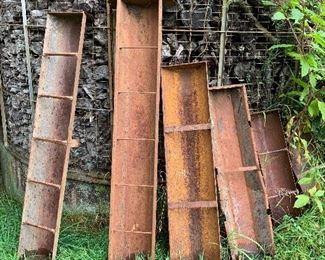 Large metal feeding troughs