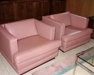 Pair of vintage 1980s club chairs upholstered in mauve vinyl