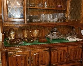 China cabinet holding Carnival ware and partial set of Fostoria Americana