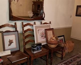 Mirror with shelf, dining chairs, prints, baskets.