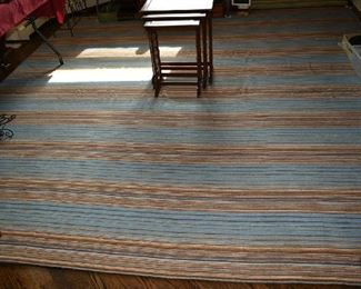 AREA RUG IN DINING ROOM 11.1' X 11.1'