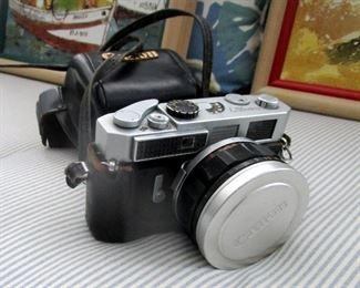 Canon 35 MM reflex camera. Giant macro lens