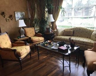 Sweet suite featuring Bergere style chairs with a damask upholstery of dragonflies, floral love seat, fruitwood nesting tables, Asian decor, potted tree, silk damask creamy yellow striped curtains....