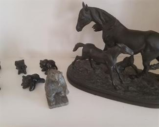 Bronze horses and eskimo carvings