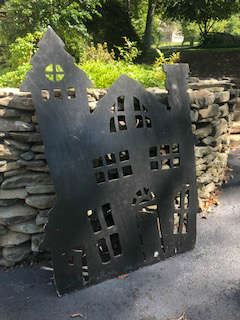 Handmade heavy wood Haunted House.  Put yellow backlight behind it and it makes a great Halloween decoration!