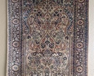Hand made hand woven oriental rug, hanging on wall...never walked on!  Approximately 3' X 5'