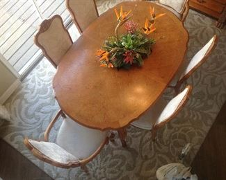 Drexel, French provincial style dining table, with six chairs and one extension leaf... birds eye view. A must see!