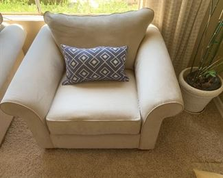 One of a pair of comfy arm chairs