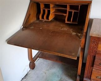 Antique Writing desk.  I moved the chair that goes with it because I am not too bright.