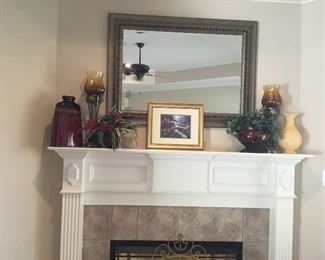 Mirror and decor items over mantle