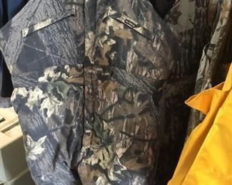 Lots of hunting clothes  and equipment; various manufacturers and various sizes.