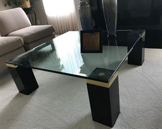 Contemporary glass Cocktail table with black lacquer legs