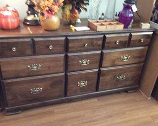 9 drawer maple dresser. Lots of lovely floral arrangements, vases Knick knacks