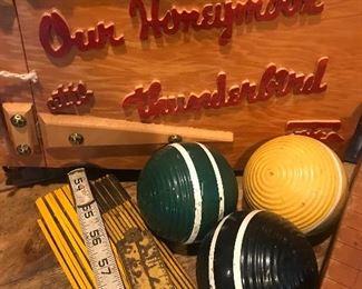 Vintage photo album, carpenter rulers, croquet balls, colorful decor