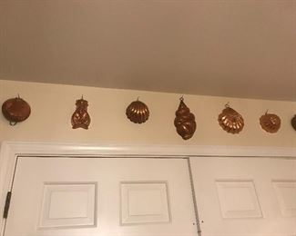 Large collection of copper molds, kitchen tools, copper wall art, fun and function