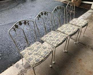 Four newly upholstered iron chairs, French toile fabric