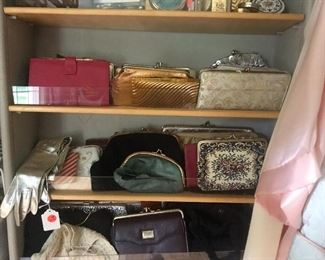 Handbags and wallets by the 100's. Huge collection of hand~picked vintage bags, wallets, compacts, gloves, and other fineries