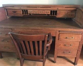 Vintage roll top desk, fun for an office or library,asking 175.00, chair included.