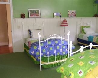 Four twin beds, two with trundles.